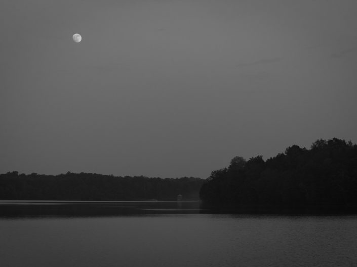 Moonrise On The Lake | Black and White Moon Landscape Photograph by Dave Butterworth | EyeWasHere Paint it Black